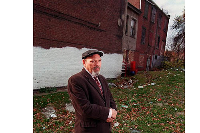 Bill Wade/Post-Gazette Playwright August Wilson in the Hill District on Bedford Avenue in front of his childhood home.